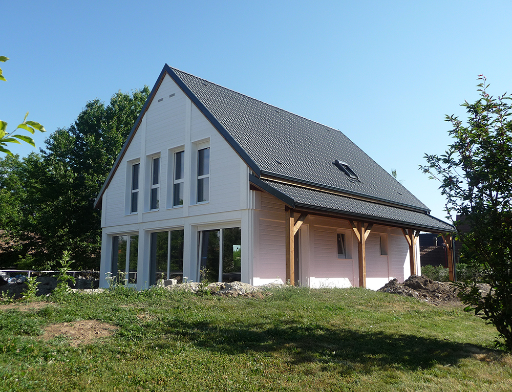 Maison avec bardage bois un lame de bardage dmontable for Construire une grande maison