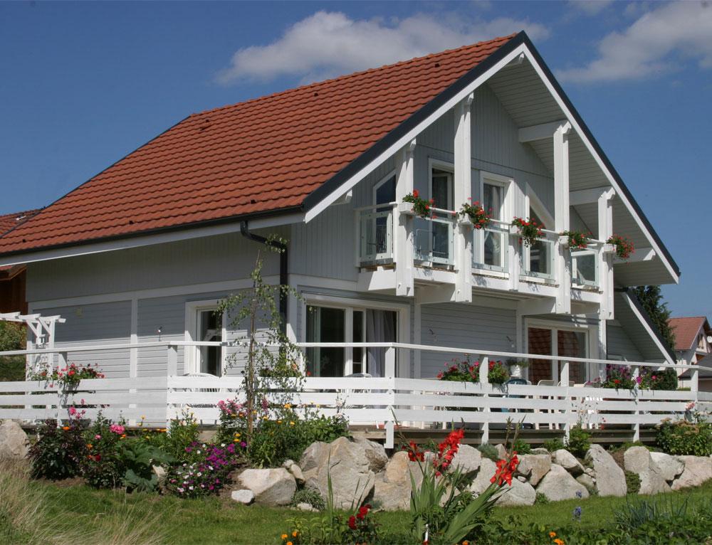 Maison bois traditionnelle avec bardage canexel nos for Maison charme et tradition