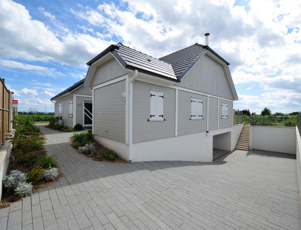 Maison bois plein pied avec bardage canexel nos maisons for Constructeur maison bois 51