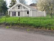 Maison à ossature bois, bardage blanc canexel
