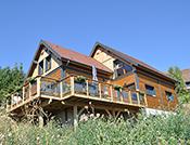 maison ossature bois type chalet grande terrasse
